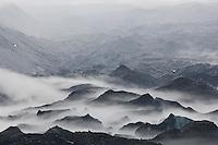 Mist forming over Tasman glacier during storm, Mount Cook national park, New Zealand