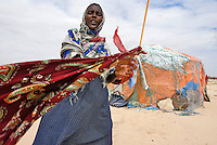 A woman outside her shelter in Eyl, an isolated coastal village on the Hafun peninsula. The village is still recovering from the Tsunami of 2004, which destroyed at least 500 fishermen's houses and boats.