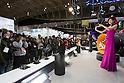 February 9, 2012, Yokohama, Japan - Visitors take photos of a campaign model showcasing one of the latest Panasonic cameras at the CP+ Camera and Photo Imaging Show 2012. The event is held from February 9-12. (Photo by Christopher Jue/AFLO)