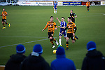 Alloa Athletic 0 Peterhead 1,14/01/2017. Recreation Park, Scottish League One. Four away supporters watching the first-half action as Alloa Athletic take on Peterhead (in blue) in a Scottish League One fixture at Recreation Park, with the Ochil Hills in the background. The club was formed in 1878 as Clackmannan County, changing the name to Alloa Athletic in 1883. The visitors won the match by one goal to nil, watched by a crowd of 504. Photo by Colin McPherson.