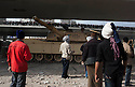 Anti-Hosni Mubarak protesters use an Egyptian Army tank as cover during clashes between Anti-Hosni Mubarak protesters and Mubarak supporters in the area around Tahrir square February 03, 201 in Cairo, Egypt. Throughout the clashes, the army took a mostly neutral stance, trying to keep the two groups separate when they could, but often pulled back and watched when the clashes became too heated.  .Photo by Scott Nelson