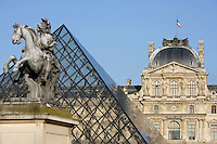 Louis XIV, Glass pyramid by I. M. Pei in 1989 and Pavillon Sully by Jacques Lemercier in 1639, Louvre Museum, Paris, France. Picture by Manuel Cohen