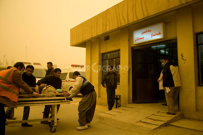 ERBIL, IRAQ: A man is brought into the Erbil Emergency Room with respiratory problems caused by a massive sandstorm...The first sandstorm of the season hits northern Iraq...Photo by Metrography