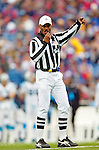 Referee Mike Carey makes a call during a game between the Buffalo Bills and the Carolina Panthers on November 27, 2005 at Ralph Wilson Stadium in Orchard Park, NY. The Panthers defeated the Bills 13-9. Mandatory Photo Credit: Ed Wolfstein