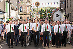 Langholm Common Riding 2016. Symbol, Barley Bannock and salted herring fastened by a large nail is held aloft by the towns folk