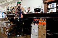 A customer shops for wine at Chambers Street Wines in New York, NY, USA, 22 May 2009. The store specializes in naturally made wines from artisanal small producers and has received a Slow Food NYC Snail of Approval.