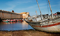 """Dry dock boat in the harbour with the defensive walls of the Portuguese Fortified city of Mazagan in the background, El Jadida, Morocco. El Jadida, previously known as Mazagan (Portuguese: Mazag""""o), was seized in 1502 by the Portuguese, and they controlled this city until 1769. Picture by Manuel Cohen"""