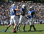 14 October 2006: Duke's John Talley (11) celebrates with Patrick Bailey (84) and Greg Meyers (34) after running an interception back 50 yards for a touchdown. The Florida State University Seminoles defeated the Duke University Blue Devils 51-24 at Wallace Wade Stadium in Durham, North Carolina in an Atlantic Coast Conference NCAA Division I College Football game.