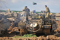 Israeli soldiers on their armed vehicle, near the Israel-Gaza border. Israeli forces began an air offensive against Hamas in Gaza on 27/12/2008, which quickly escalated into an offensive by land, sea and air, in retaliation against Palestinian rockets fired into Israel. After eight days of bombardment, leaving over 400 Palestinians and four Israelis dead, Israeli tanks entered Gaza on 04/01/2009...