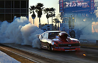 Mar. 11, 2011; Gainesville, FL, USA; NHRA pro mod driver Rickie Smith does a burnout during qualifying for the Gatornationals at Gainesville Raceway. Mandatory Credit: Mark J. Rebilas-