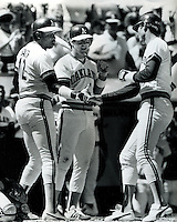 A's Home Run: Dave Kingman is greeted at home by .Dusty Baker and Mike Heath. (1985 photo/Ron Riesterer)