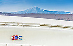 5 December 2014: Alexandr Peretjagin, sliding for Russia, slides through Curve Number 14 on his first run, ending the day with a 5th place finish and a combined 2-run time of 1:43.217 in the Men's Competition at the Viessmann Luge World Cup, at the Olympic Sports Track in Lake Placid, New York, USA. Mandatory Credit: Ed Wolfstein Photo *** RAW (NEF) Image File Available ***