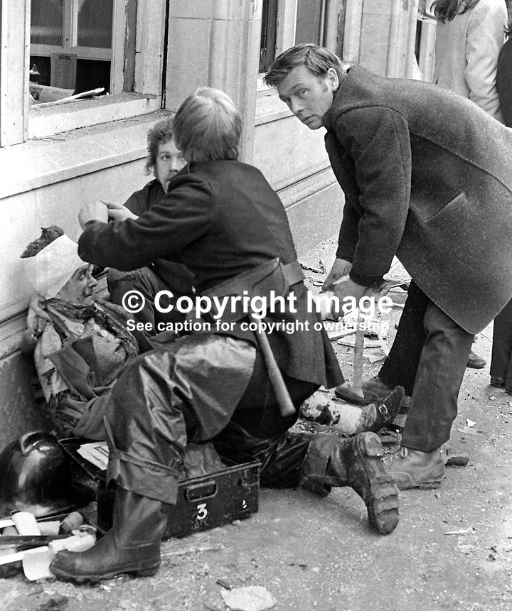 Scene of no warning car bomb explosion in Lower Donegall Street, Belfast, in which seven people died and 130 were injured. Four of the dead were binmen. Fireman administers first aid to an injured woman.19720320005...Copyright Image from Victor Patterson, 54 Dorchester Park, Belfast, UK, BT9 6RJ..Tel: +44 28 9066 1296.Mob: +44 7802 353836.Voicemail +44 20 8816 7153.Skype: victorpattersonbelfast.Email: victorpatterson@mac.com.Email: victorpatterson@ireland.com (back-up)..IMPORTANT: If you wish to use this image or any other of my images please go to www.victorpatterson.com and click on the Terms & Conditions. Then contact me by email or phone with the reference number(s) of the image(s) concerned.
