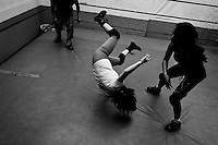 """A female Lucha libre wrestler throws down her sparring partner during the training classes at a combat sports gym in Mexico City, Mexico, 28 April 2011. Lucha libre, literally """"free fight"""" in Spanish, is a unique Mexican sporting event and cultural phenomenon. Based on aerial acrobatics, rapid holds and the use of mysterious masks, Lucha libre features the wrestlers as fictional characters (Good vs. Evil). Women wrestlers, known as luchadoras, often wear bright shiny leotards, black pantyhose or other provocative costumes. Given the popularity of Lucha libre in Mexico, many wrestlers have reached the cult status, showing up in movies or TV shows. However, almost all female fighters are amateur part-time wrestlers or housewives. Passing through the dirty remote areas in the peripheries, listening to the obscene screams from the mainly male audience, these no-name luchadoras fight straight on the street and charge about 10 US dollars for a show. Still, most of the young luchadoras train hard and wrestle virtually anywhere dreaming to escape from the poverty and to become a star worshipped by the modern Mexican society."""