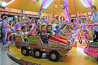 Merry-go-round, fiesta, San Pedro de Alcantara, Marbella, Spain, 15th October 2015, 201510151771<br /> <br /> Copyright Image from Victor Patterson, 54 Dorchester Park, Belfast, UK, BT9 6RJ<br /> <br /> t1: +44 28 9066 1296 (from Rep of Ireland 048 90661296)<br /> t2: +44 28 9002 2446 (from Rep of Ireland 048 90022446)<br /> m: +44 7802 353836<br /> <br /> e1: victorpatterson@me.com<br /> e2: victorpatterson@gmail.com<br /> <br /> www.victorpatterson.com<br /> <br /> IMPORTANT: Please see my Terms and Conditions of Use at www.victorpatterson.com