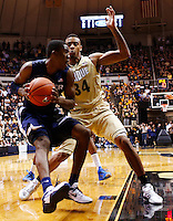 WEST LAFAYETTE, IN - DECEMBER 01: Semaj Christon #0 of the Xavier Musketeers dribbles to the hoop as Jacob Lawson #34 of the Purdue Boilermakers defends at Mackey Arena on December 1, 2012 in West Lafayette, Indiana. Xavier defeated Purdue 63-57. (Photo by Michael Hickey/Getty Images) *** Local Caption *** Semaj Christon; Jacob Lawson