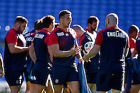 Sam Burgess of England speaks to team-mate Dan Cole. England Captain's Run on October 9, 2015 at Manchester City Stadium in Manchester, England. Photo by: Patrick Khachfe / Onside Images