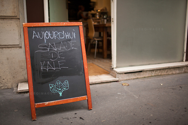 The Superfoods Cafe in Paris advertises kale salad for sale.<br /> <br /> Kristen Beddard, 29, of The Kale Project, in Paris, France.  Kevin German / Luceo