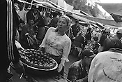A woman sells tomatos in the Jayma bazaar in the city of Osh. The city was once one of the great cities of the Silk Road and of Central Asia, and is the second biggest city in the country, situated in the unstable Ferghana valley which is now becoming a hotbed if Islamic Fundamentalism. Osh,  Kyrgyzstan.