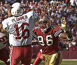 San Francisco 49ers defensive end Andre Carter (96) rushes Arizona Cardinals quarterback Jake Plummer (16) on Sunday, October 27, 2002, in San Francisco, California. The 49ers defeated the Cardinals 38-28.