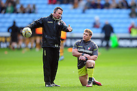 Leicester Tigers Head Coach Aaron Mauger with Tom Youngs during the pre-match warm-up. Aviva Premiership match, between Wasps and Leicester Tigers on January 8, 2017 at the Ricoh Arena in Coventry, England. Photo by: Patrick Khachfe / JMP