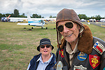 This gentleman is all decked out in the proper uniform for flying in a 1928 Travel Aire biplane, which he and his wife did soon after.