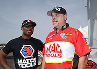 Apr. 7, 2013; Las Vegas, NV, USA: NHRA top fuel dragster driver Antron Brown (left) talks with Jim Oberhofer during the Summitracing.com Nationals at the Strip at Las Vegas Motor Speedway. Mandatory Credit: Mark J. Rebilas-