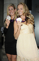 April Ross & Jennifer Kessy .The Prince Albert II of Monaco Olympians Reception, Old Burberry Building, Haymarket, London, England..August 9th, 2012.half length black dress beige medal winner .CAP/CAN.©Can Nguyen/Capital Pictures.