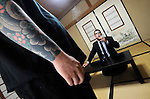 """Jake Adelstein, a former reporter at Japan's largest daily newspaper, Yomiuri Shimbun, and author of Tokyo Vice speaks with his bodyguard, a former yakuza mobster who goes by the name """"Mochizuki,"""" at an undisclosed location in Japan on Aug. 29, 2008. In 2005 American Adelstein uncovered a scandal involving senior members of Japan's mafia, the yakuza, visiting a medical center in Los Angeles to undergo liver transplants, despite being bared from entry due to having criminal records or suspected affiliation with Japanese organized crime groups. Within days, however, Adelstein was visited by mob members and told to either """"erase the story or be erased."""" He took the former option and resigned from the Yomiuri, though a  leak of his story at one time pushed Adelstein and his family into hiding..Photographer: Robert Gilhooly"""