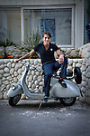 Photo of an Italian guy on vintage scooter in Sorrento, Italy.