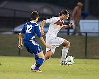 Winthrop University Eagles vs the Brevard College Tornados at Eagle's Field in Rock Hill, SC.  The Eagles beat the Tornados 6-0.  Adam Brundle (12) makes a run.