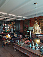 The living area and master bedroom walls are clad in antiqued raw oak panelling, a foil to a stunning collection of art, ranging from Turkish painters to nineteenth century French works of art