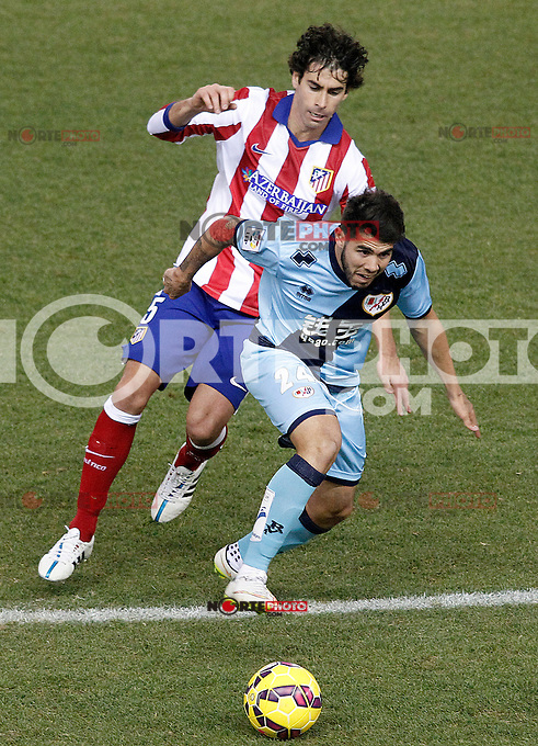 Atletico de Madrid's Tiago Mendes (l) and Rayo Vallecano's Alejandro Pozuelo during La Liga match.January 24,2015. (ALTERPHOTOS/Acero) /NortePhoto<br /> NortePhoto.com