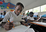Students in a school classroom in Batey Bombita, a community in the southwest of the Dominican Republic whose population is composed of Haitian immigrants and their descendents.