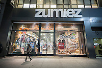 Shoppers pass a Zumiez store in Herald Square in New York on Tuesday, January 12, 2016. Zumiez announced that it has partnered with Starmount to engage customers with an omnichannel point of sale experience. Starboard provides a mechanism integrating online sales, store operations and the all important access to data including inventory.  (© Richard B. Levine)