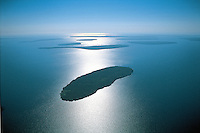 Wisconsin. Apostle Nat. Lakeshore, Lake Superior, Islands, Aerial, Sunrise, These United States page 72 left