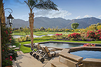 View of backyard swimming pool overlooking a golf course and mountains