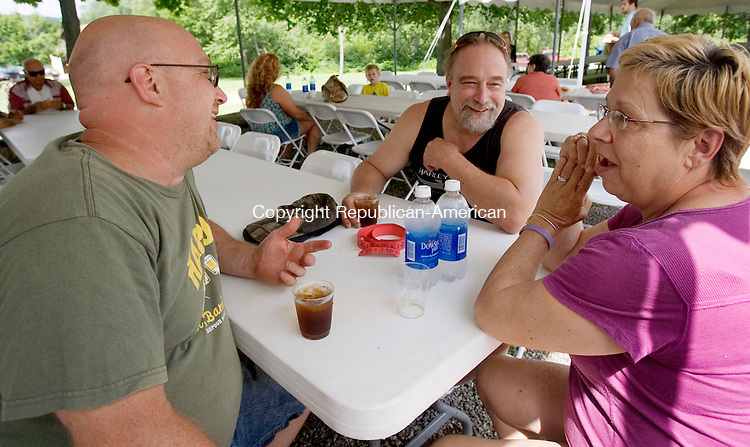 WATERTOWN CT. 29 June 2013-062913SV13-From left, Andre Chicoine talks with his brother Normand Chicoine , and his wife Anne Chicoine  all of Oakville during the Cercemaggiore Community Club annual Italian Festival in Watertown Saturday.<br /> Steven Valenti Republican-American