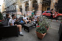 "Il bar ""Caffè Nero"".I ciclisti Domenico Priore, Domenico Butti e Cristian Colaiacomo..Dopo il terremoto  del 2009 alcuni negozi e attività commerciali riaprono a L'Aquila..After the earthquake of 2009, some shops and businesses reopen in L'Aquila."
