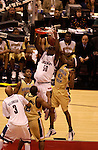 5 APR 2004:  Emeka Okafor (50) of the University of Connecticut dunks against Clarence Moore (42) of Georgia Tech during the final game of the NCAA Division I Men's Basketball Championship held at the Alamodome in San Antonio, TX. University of Connecticut defeated Georgia Tech 82-73 to win the national title. Brett Wilhelm/NCAA Photos