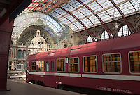 Passenger train and the atrium on the main level of Antwerp's Central Station