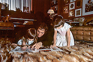 """March 1, 1971. New Jersey. Paul Anka and daughters at home. Paul Anka (b. July 30, 1941) is a Canadian singer, songwriter and actor who became famous with the hit songs """"Diana"""", """"Lonely Boy"""" and """"Put Your Head on My Shoulder"""", as well as famously wrote the well-known theme music for The Tonight Show Starring Johnny Carson and one of Tom Jones's biggest hits, """"She's a Lady""""."""