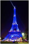 Eiffel Tower at night, lit with blue light [La Tour Eiffel par nuit en lumière bleue]