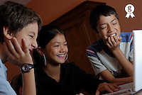 Three children (10-13) using laptop, close-up (Licence this image exclusively with Getty: http://www.gettyimages.com/detail/200476761-003 )
