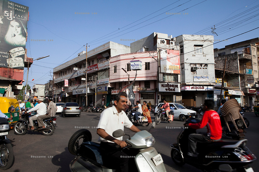 People go about their daily lives in the town of Anand, Gujarat, India on 17 May 2011. Photo by Suzanne Lee
