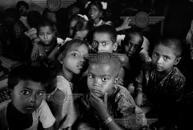 Children of prostitutes and slum dwellers attending a charity school in the red light district.