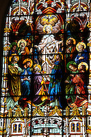 Stained glass image depicts Mary's assumption into heaven. (Sam Lucero photo)