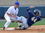 Third baseman Jacob Midkiff (8) of the Presbyterian Blue Hose grabs the throw from home as well as a leg of A.J. Lardo (44) of the University of Pittsburgh Panthers who was out attempting to advance on a single in a game on Tuesday, March 11, 2014, at Fluor Field at the West End in Greenville, South Carolina. Pitt won, 12-3. (Tom Priddy/Four Seam Images)