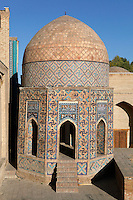 General view of octagonal pavilion, Mausoleum of the middle group, 1380s, Shah-I Zindah Complex, Samarkand, Uzbekistan, pictured on July 19, 2010, in the early morning. The Shah-i-Zinda Complex is a necropolis of mausoleums whose legendary origin dates back to 676 when Kussam-ibn-Abbas arrived to convert the locals to Islam. So successful was he that he was assassinated whilst at prayer. His grave remains the centre of the sacred site which grew over many centuries, especially the 14th and 15th, into an architecturally stunning  example of ceramic art. Samarkand, a city on the Silk Road, founded as Afrosiab in the 7th century BC, is a meeting point for the world's cultures. Its most important development was in the Timurid period, 14th to 15th centuries. Picture by Manuel Cohen.