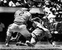 A's catcher Mike Heath tags out Seattle runner Spike Owen. (1984 photo by Ron Riesterer)